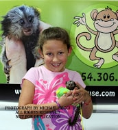 holding her baby marmoset