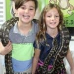 kids with a snake on their shoulders