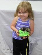 carefully holding baby marmoset
