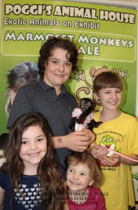 Mother and kids holding a Capuchin Monkey