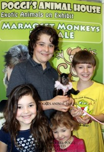 Mom with kids holding a Capuchin Monkey