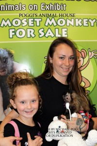 Mother daughter holding a Capuchin Monkey