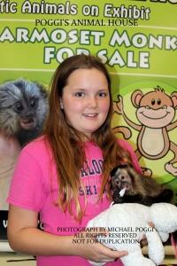 Girl holding Capuchin Monkey