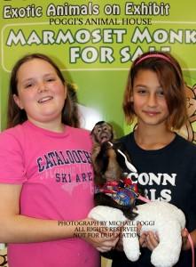 Girls holding a little Capuchin Monkey